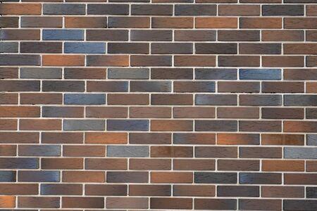 colorful brick wall facade (texture background) useful Uneven stone surface for backdrop vintage construction. Banco de Imagens