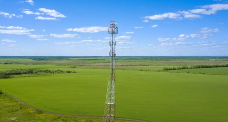 aerial photo of a mobile phone tower on the background of a beautiful landscape