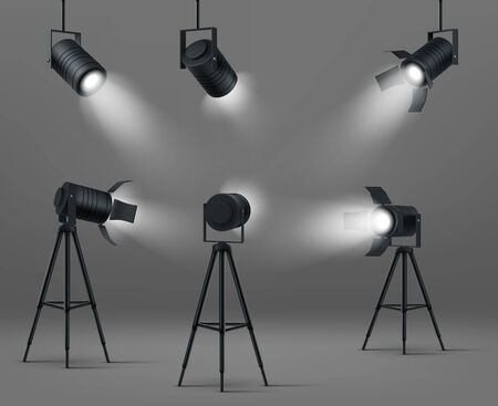 Spotlights for studio or stage. Vector realistic set of glowing floodlights for illumination show, concert or podium. Black spot lamps on stand and hanging on gray background
