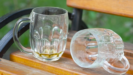 The end of the holiday. Beer mugs on the bench Stok Fotoğraf