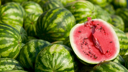 Sale of watermelons. Red and juicy watermelon. Attracts insects with its sweetness.