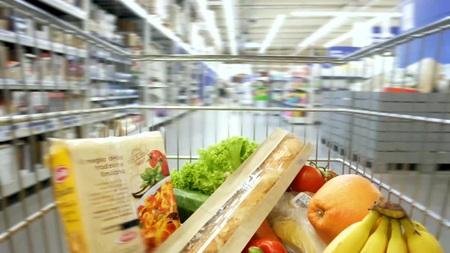 Vegetables inside shopping cart. Time lapse. Hyper lapse 写真素材