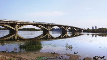 Beautiful cityscape of metro train on the bridge in Kiev. Dnipro station