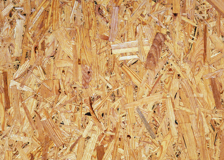 Particle board texture. Pressed wooden panel background. Oriented strand board - OSB