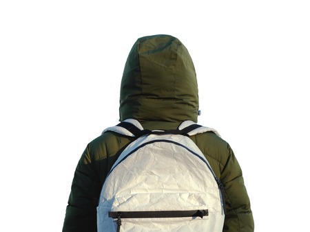 Strange person in the backpack on a white background isolated. Winter travel concept Stok Fotoğraf