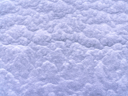 Texture of a snow-covered slope. small snow down poured a large snowdrift