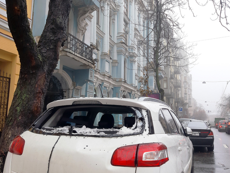 An icicle falling from the roof smashed the cars rear window Stok Fotoğraf