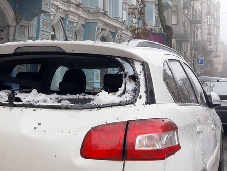 An icicle falling from the roof smashed the cars rear window. Close up Stok Fotoğraf