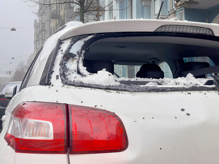Snow from the roofs fell on the car and broke the rear window. Close up