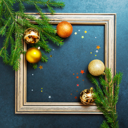 Merry christmas happy new year concept fir tree holiday winter balls decorating gold stars glitter wooden photo frame copy space Background Flat Lay Stock Photo