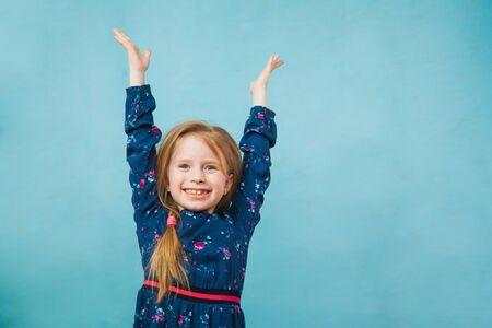 Happy delighted girl in denim jacket smile with hands up. Positive emotion, copy space for text, advertising concept.