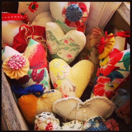 Collection of mini heart pillows in a wooden box.  Stock Photo