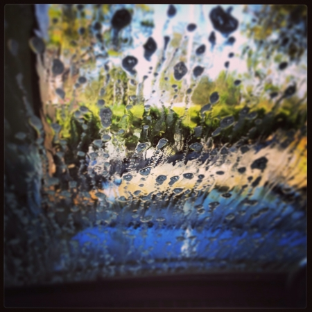 Image if sudsy water on a car windshield inside a car wash  Stock Photo