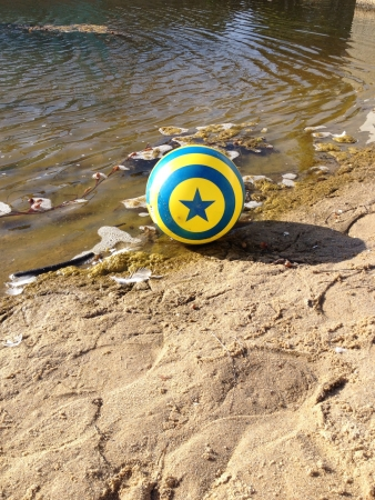 Lost blue and yellow ball at the beach