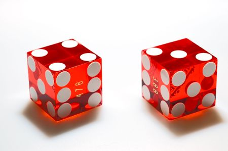 Real, red casino dice on a white background. Clipping path. photo
