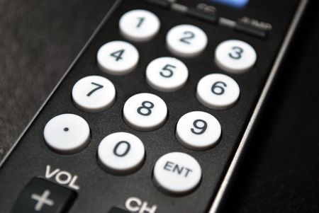 Close up of the numbers on a remote control