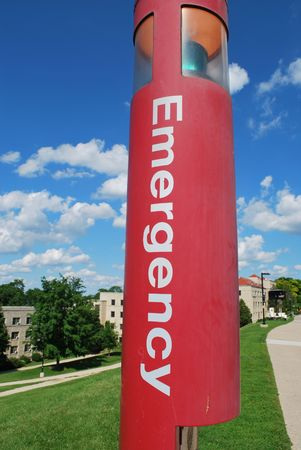 An emergency phone by a college dormitory Imagens