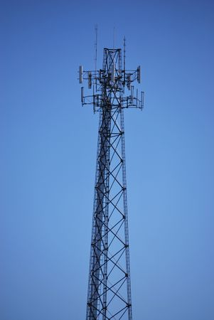 A cell phone tower on a clear sunny day