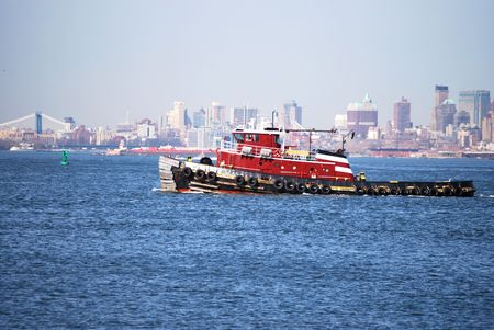 A tugboat floats in the Upper New York Bay Stock Photo