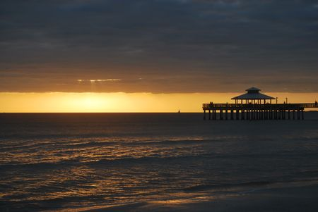 Fort Myers Beach and pier at sunset Stock Photo