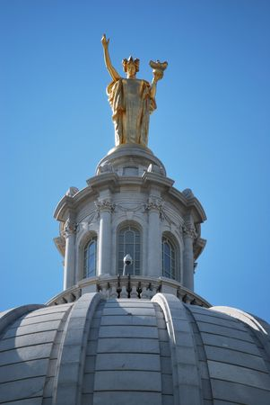 Miss Forward on top of the Madison, WI capitol building
