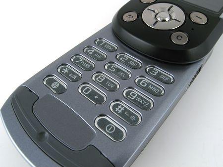 Afzonderlijke mobiele telefoon toetsenbord met een deel van de joystick zichtbaar