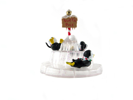 north pole: 3 penguins on ice with north pole sign - Christmas ornament