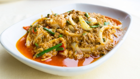 Stir-Fried crab with Garlic, Peper, Curry Powder on plate  photo
