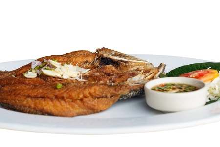 white perch: Fried white perch Fish with Fish sauce, delicious thai food. Stock Photo