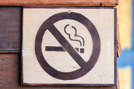 No smoking sign on the wooden wall. photo