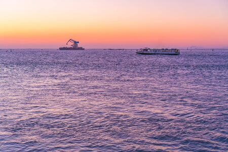 Sunset over the Venice lagoon with a ferry
