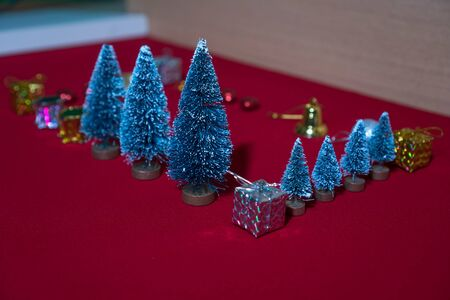 Small Christmas decorations resting on the red carpet