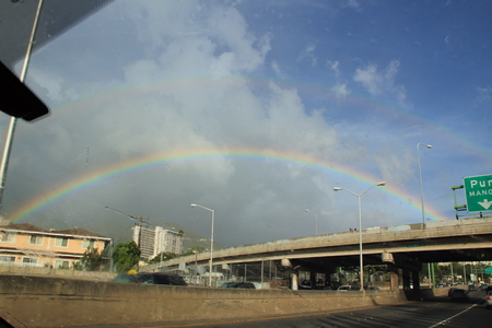 The rain stopped, and when I looked into the sky there was a rainbow. Foto de archivo