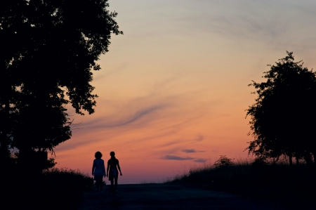 Girls walking in the sunset photo