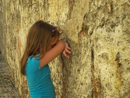 Beautiful girl hiding her face Stock Photo - 2354524