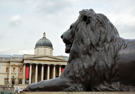 nebulous: The National Gallery in Trafalgar Square ,London with a bronze lion in the foreground