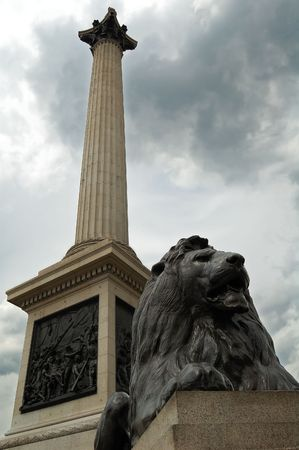 Vertical view of the Nelson Column in Trafalgar Square,London with a bronze lion Stock Photo - 3257804