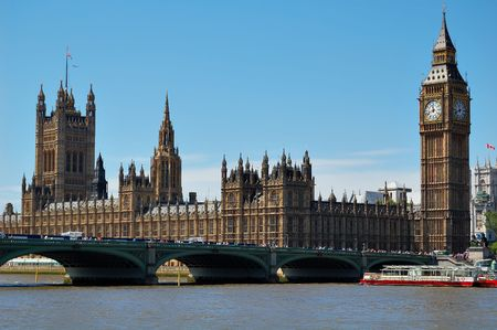 westminster: The Big Ben, the Houses of Parliament and Westminster Bridge in a clear day Фото со стока