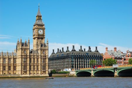 The Big Ben, the Houses of Parliament and Westminster Bridge in a clear day photo
