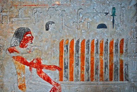 decaying: Ancient egyptian painting with hieroglyphs engraved in stone