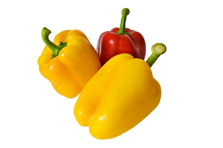 Yellow and red peppers isolated on a white background photo