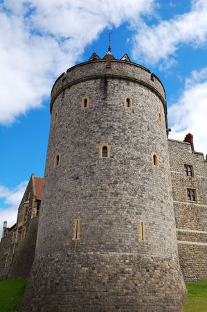 A tower in a corner of Windsor Castle in England photo