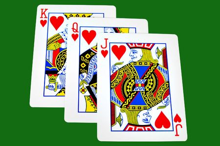 King,Queen and Jack of hearts iolated on green with clipping path Editorial