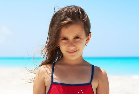 Portrait of a beautiful caucasian girl smiling in the beach Stock Photo - 5559555