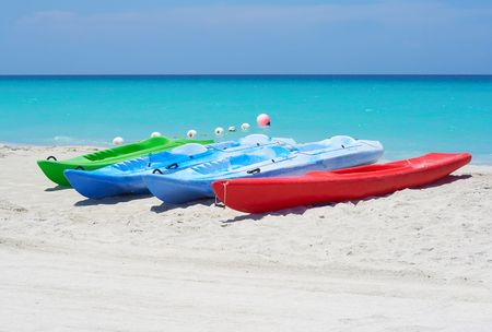 Group of kayaks ready to be rented in a beach photo