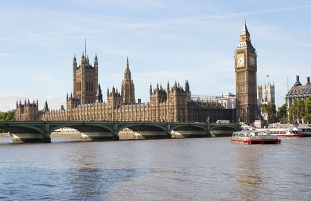 The Big Ben and Westminster bridge in London in a beautiful day photo