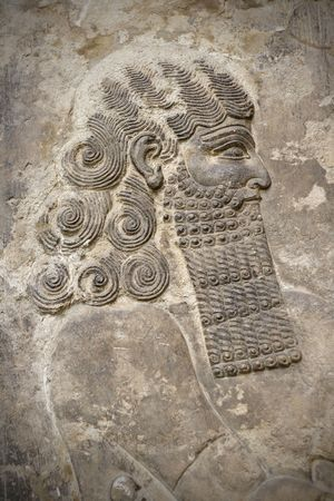 enduring: Head of an ancient assyrian warrior carved in stone