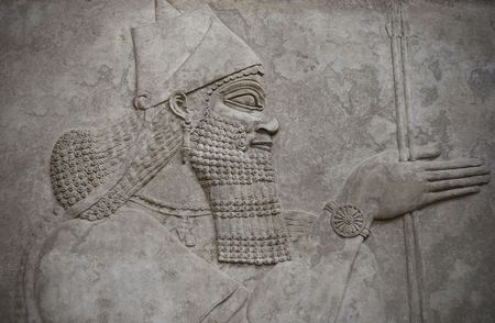 babylonian: Head of an ancient assyrian warrior carved in stone