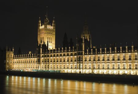 office politics: The Houses of Parliament in London illuminated at night Stock Photo