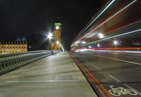 The Big Ben and Westminster Bridge at night with traffic light trails photo